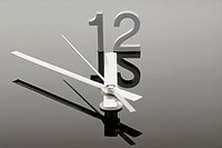 Clock showing five to twelve, symbolic image for high time