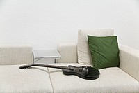 Sofa with electric guitar