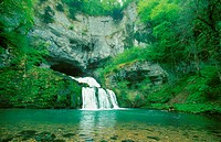 cave, Source de Lison, entance of effluent cave with waterfall, France, Doubs
