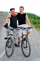 Friendship, two friends on mountain bikes