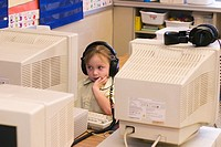 Toledo, Ohio - A kindergarten girl works on a computer at East Side Central Elementary School in the Toledo public school system