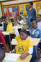 Detroit, Michigan - Students raise their hands in a Grades 5-6 class at Guyton Elementary School, part of the Detroit Public School system