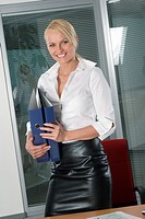 blond secretary wearing black leather skirt.