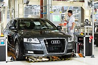 An Audi employee working on the suspension set-up of an Audi A6 Avant S-Line at the control centre of the Audi plant in Neckarsulm, Baden-Wuerttemberg...