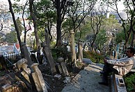 Man taking a break on an old Muslim cemetery in Eyuep, Golden Horn, Istanbul, Turkey