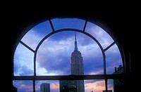 New York, NY - The Empire State Building, framed by a window in a Manhattan office building