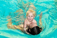 mother and son together in swimming pool