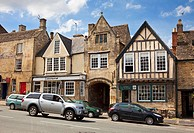 Old Cotswold stone and medieval half timbered shops in Burford, Oxfordshire, England, UK