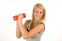 Young blonde woman in sportswear with dumbbells