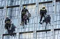 Glass facade, window cleaners, back view, skyscraper, Frankfurt, Hesse, Germany, Europe