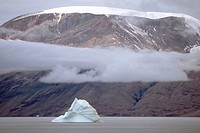 iceberg in front of coastal scenery at Antarctic Sund, Greenland, East Greenland, Groenland Nationalpark, Tunu