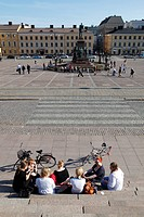 Finland, Helsinki, Helsingfors, Senate Square, Tourists Sitting on the Steps of The Cathedral