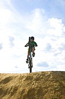 A boy on a mountain bike, on a bike track