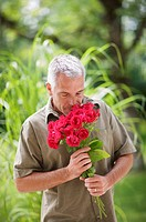 outdoor portrait of a man and roses