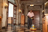 Stephen Gaines polishes a floor at the Quadrangle Club, a private club at the University of Chicago, Chicago, Illinois, USA