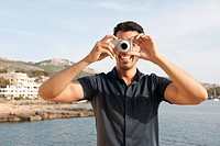 Man Taking Picture with Camera