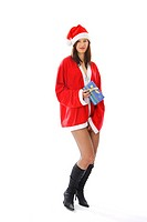 young woman in Santa Claus costume and fish net stockings holding Christmas gift