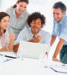 Happy business people using laptop