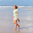 Young woman walking at the beach