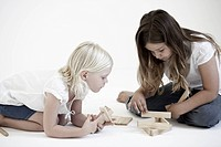 Young girls playing with building blocks