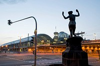 Main railway station at dusk, sculpture in foreground, Dresden, Saxony, Germany