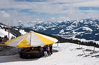 Alpine bar with sunshade, Skiworld, Wilder Kaiser with view of the Loferer Steinberge mountain range and Leoganger mountains, Tyrol, Austria