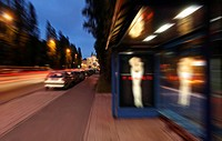 Evening mood, Leopold street, busstop with luminous advertising, Munich, Bavaria, Germany