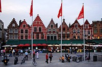 Houses with stepped gables and restaurants, Market Square, Bruges, Belgium, Europe
