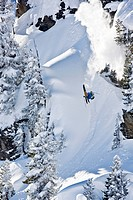 Freestyle skier doing a somersault from a mountain terrain, Kaltenbach, Zill Valley, North Tyrol, Austria, Europe