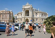 Passers-by in front of the Opera House in Odessa, Black Sea, Ukraine, Eastern Europe, Europe