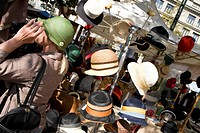 Woman trying on a hat, hats, hat sale, flea market, Buerkliplatz Square, Zurich, Switzerland
