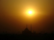 Sunset over Mohammed Ali Mosque _ smog silhouette of Cairo, Egypt, Kairo