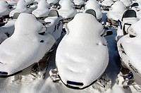 snow covered snow mobiles, France, Savoie
