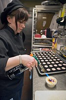 Marlene Ward, pastry chef at Small Plates restaurant, making creme brulee, Detroit, Michigan, USA