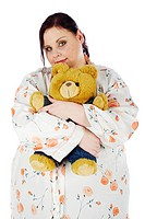 Young, fat woman holding a teddy bear