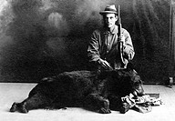 Hunter with a bear, historic photograph, around 1912