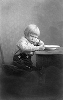 Boy in a bad mood, historical image, ca. 1912