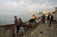 Fishermen bringing in nets, Waterfront at the Mediterranian sea, Egypt, Alexandria