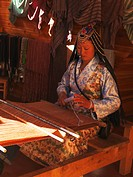 Tibetan woman on a weaving loom, Zhongdian, in Tibetan Gyeltangeng, Tibet, China, Asia