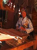 Tibetan woman on a weaving loom, Zhongdian, in Tibetan Gyeltangeng, Tibet, China, Asia