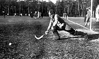 Historic photo, woman playing hockey, ca. 1925