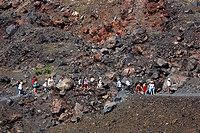 tourists walking through lava, Greece, Santorin, Nea Kameni