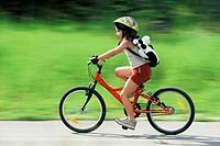 young girl mountainbiking, France