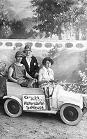 Historic photograph, three women in a cardboard car, around 1920