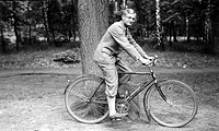 Historic photograph, man on a bicycle, around 1925