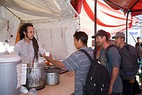 An aid station on the Mexican side of the US border provides food and water, bandages blisters of those who have been walking in the desert, lists eme...