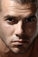 Thirty years old man dramatic expressive closeup face portrait