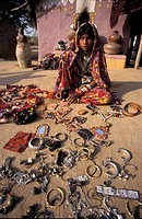 Harijan girl dressed in colourful sari selling trinkets, Ludia Village, North of Bhuj