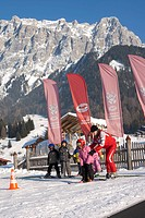 Children being taught by a ski instructor in a beginners course in a ski school in front of Zugspitze mountain, Ehrwald, Tyrol, Austria, Europe