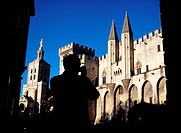 Man taking picture of the Palais des Papes and the Cathedrale Notre Dame des Doms